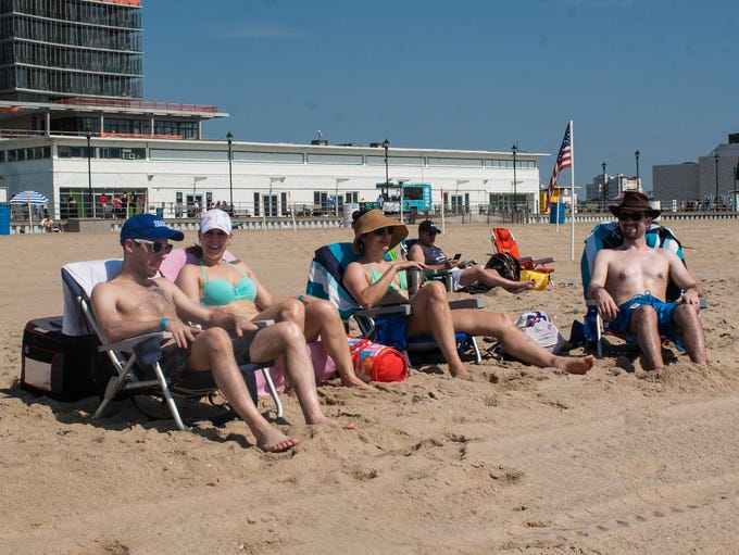 Beachgoers sunbathing and relaxing at Asbury Park Beach