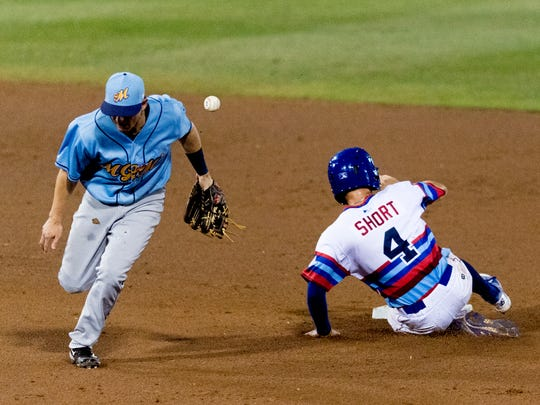 Smokies infielder Zack Short (4) slides safely into third as Biscuits infielder Nick Solak (14) loses control of the ball during a game between the Tennessee Smokies and Montgomery Biscuits at Smokies Stadium in Kodak, Tennessee on Friday, June 15, 2018.
