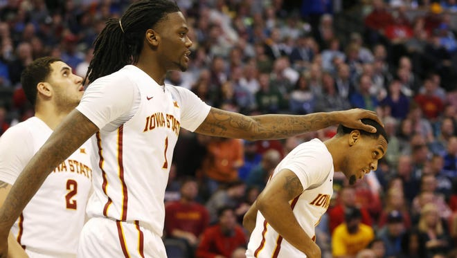 Iowa State forward Jameel McKay (1) gives guard Monte Morris (11) a rub on the head after Morris was fouled by Little Rock Saturday in the second round.