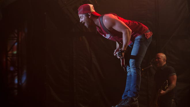 Kip Moore performs on the main stage at Country Thunder music festival on Thursday, Apr. 7, 2016 in Florence, Ariz.