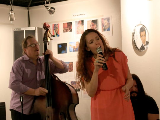 "Artist and musician Carlyle Potter, on bass, performs alongside Laura Lounsbury on vocals and Kevin Jones on guitar during the Saturday opening for Potter's exhibit ""Jazz as Art as Jazz"" at the DiFiore Center in St. George."
