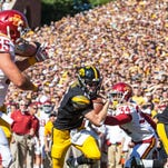 Iowa's Jake Rudock (15) runs in for a touchdown past Iowa State's Nigel Tribune (34) during the in-state rivalry Cy-Hawk Trophy game at Kinnick Stadium in Iowa City on Saturday, September 13, 2014. The Cyclones won 20-17 on a late field goal in the fourth quarter.
