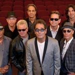 Unlike many of their peers, Huey Lewis & The News still includes most of its original members — with a couple of more recent additions.