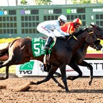 Gimme Da Lute and jockey Martin Garcia, right, outleg Prospect Park (Tyler Baze), left, to win the Grade II, $350,000 Los Alamitos Derby, Saturday, July 4, 2015 at Los Alamitos Race Course, Cypress CA. © BENOIT PHOTO