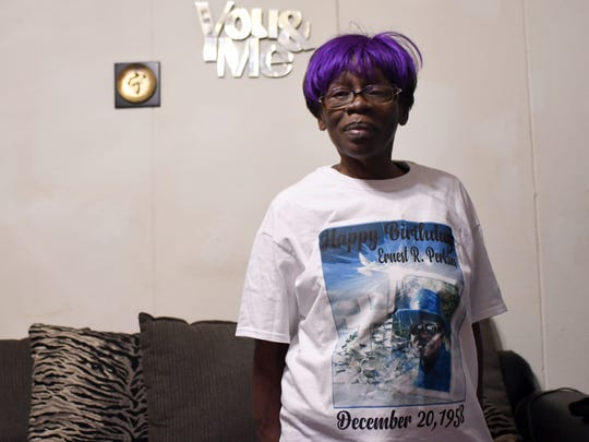 Rosa Perkins wears a shirt honoring her husband, Earnest Perkins, who lost his life in the Jan. 21, 2017, tornado.