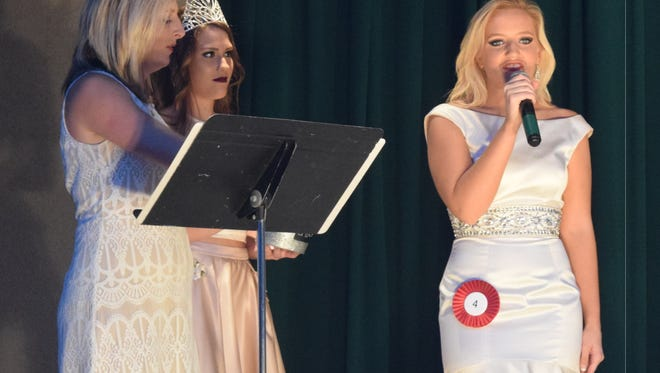 Alix Fuqua answers a question for the judges during the Miss Corn Festival Pageant.