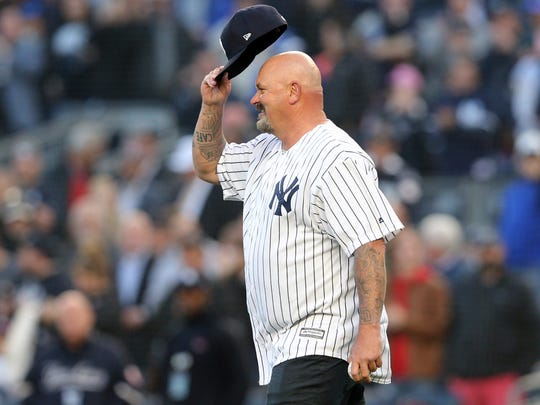 Former Yankees pitcher David Wells tips his cap to the fans before throwing out the ceremonial first pitch before a game against the Minnesota Twins at Yankee Stadium. Wells threw out the first pitch to commemorate the twentieth anniversary of his perfect game.