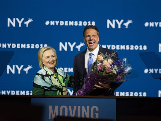 HEMPSTEAD, NY - MAY 23: Gov. Andrew Cuomo brings flowers after Hillary Clinton's speech during the New York Democratic convention at Hofstra University on May 23, 2018 in Hempstead, New York. Clinton attended the event to support Governor Cuomo's bid for a third term. (Photo by Kevin Hagen/Getty Images)