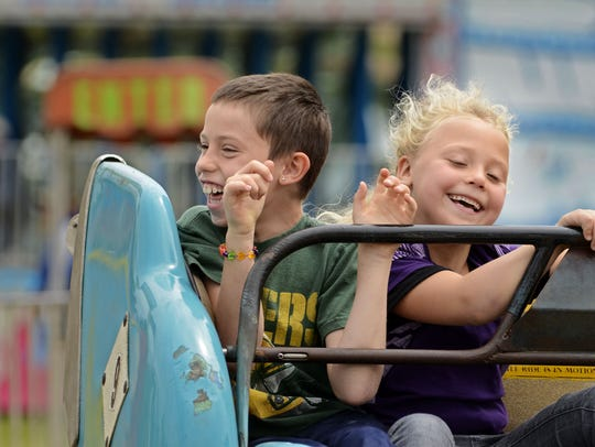 File - Amusement rides are one of the Mishicot Riverfest