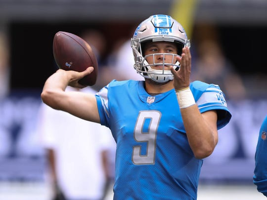 Matthew Stafford warms up before an exhibition against the Colts on Aug. 13, 2017 at Lucas Oil Stadium in Indianapolis.