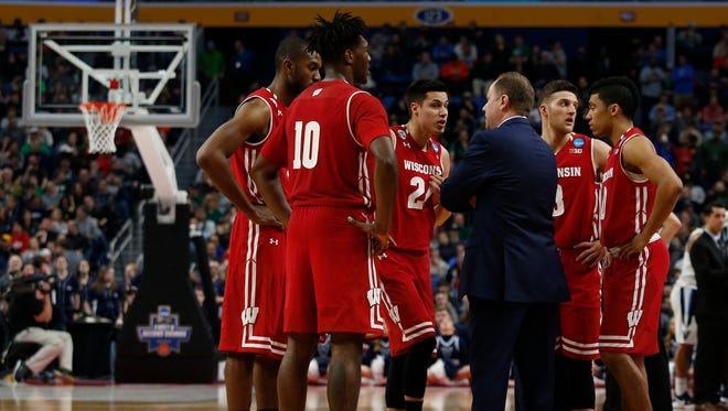 Badgers coach Greg Gard huddles with his team in the final minute of UW's upset of top-seeded Villanova Saturday in the second round of the NCAA Tournament.