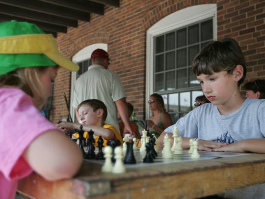 Ruby Ann Malek, 10, of Sturgeon Bay, Wis., faces off against Matthew Munford of Salem in the speed chess tournament Wednesday afternoon at the 2008 Iowa State Fair.