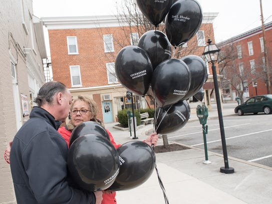 Vicki Rhodes chats with Mike Straley in the Greencastle Square on Tuesday as they carry balloons in honor of their daughters and others who died from a drug overdose. Rhodes' daughter Teri died in 2015 right after turning 41, and Straley's daughter Leah died three weeks ago, on Feb. 14 at age 26.