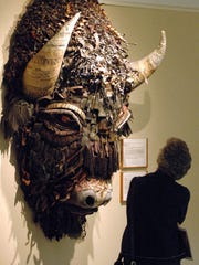 A woman looking at Buffalo, a mixed media piece by artist Holly Hughes, part of the Capitol Art Collection at the Capitol in Santa Fe, N.M. on Jan. 27, 2006.