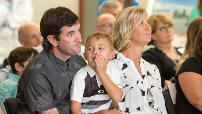 Bubba Watson, his wife and Angie and his son, Caleb  watch tribute video on Sept. 8, 2017 when he announced his $2.1 million donation to the Studer Family Children's Hospital at Sacred Heart. Watson is profiled in new video produced by PGA Tour:  Bubba Watson Home Again.