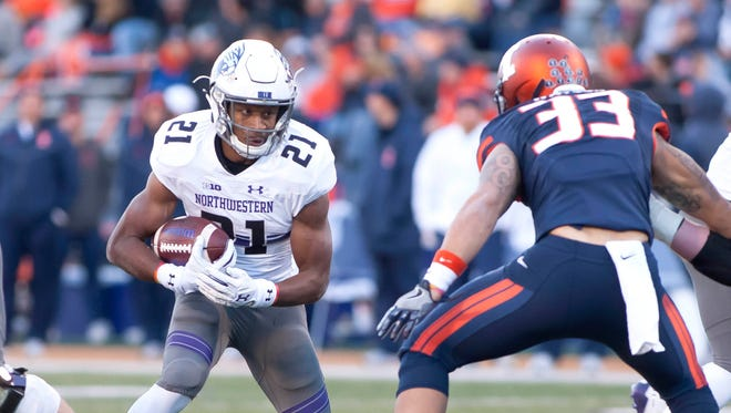 Nov 25, 2017; Champaign, IL, USA; Illinois Fighting Illini linebacker Tre Watson (33) pursues Northwestern Wildcats running back Justin Jackson (21) during the first quarter at Memorial Stadium. Mandatory Credit: Mike Granse-USA TODAY Sports