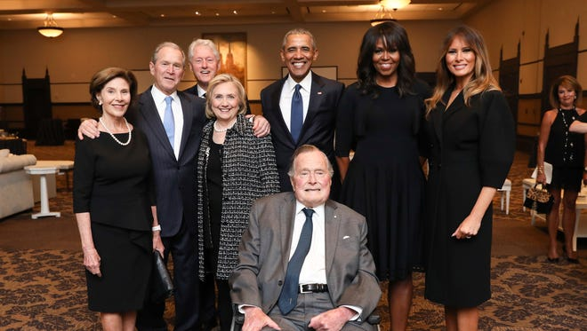 This Saturday, April 21, 2018, photo provided by the Office of former U.S. President George H.W. Bush, shows Bush, front center, and past presidents and first ladies Laura Bush, from left, George W. Bush, Bill Clinton, Hillary Clinton, Barack Obama, Michelle Obama and current first lady Melania Trump in a group photo at the funeral service for former first lady Barbara Bush, in Houston. Barbara Bush died Tuesday, April 17. She was 92.