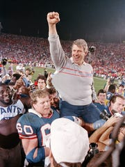 Winner: New York Giants | MVP: Phil Simms | New York Giants coach Bill Parcells is carried off the field in 1987 after Super Bowl XXI.