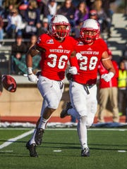 LeShaun Sims and Miles Killebrew run off the field after an interception by Sims in the game against Northern Arizona, Nov. 21, 2015.