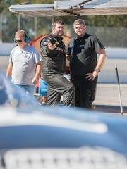 Driver Bubba Pollard, center, chats while testing at Five Flags Speedway on Nov. 22 in Pensacola. Teams are getting ready for the annual Snowball Derby.