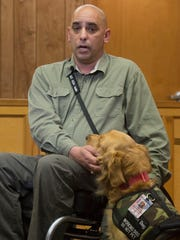 Former Army Sgt. Matthew Kopcsak, and his service dog, Sarge, is in a legal battle with former landlord, Roger Dale Register, in part over his service animal.