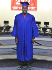 Robert Ocke-Hall in his Warrick Education Center graduation cap and gown