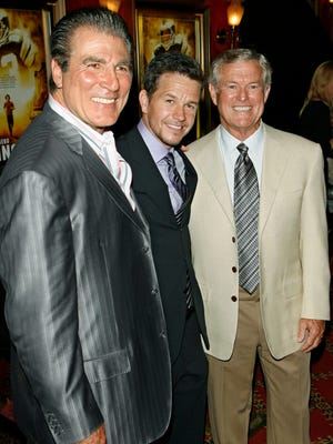 "From left, Vince Papale, actor Mark Wahlberg and former Eagles coach Dick Vermeil, pose for photographers during red carpet arrivals at the world premiere of the film ""Invincible"" in 2006."