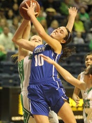 Eden High School's Devon Kinnibrugh (10) puts up a