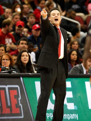 University of Louisville head coach Rick Pitino react to his teams play against Jacksonville State during the first half of play at the KFC Yum! Center in Louisville, Kentucky.       November 17, 2014