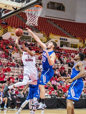 Ragin Cajuns guard Jay Wright (1) draws the foul on Texas-Arlington forward Nick Pallas (30) while going up for a layup in UL's win over UTA on Saturday at the Cajundome. Jan. 30, 2016