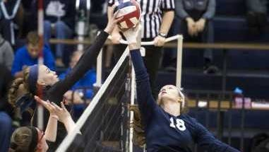 West York's Trilby Kite, right, and Palmyra's Taylor McInerney battle for a tip toward the end of the third set, Saturday, November 4, 2017.