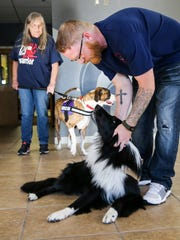 Matthew Ledbetter practices skills with his service dog, Sergeant, at a TADSAW meeting Tuesday, June 27, at Freedom Fellowship Church.