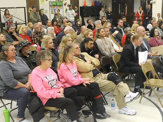 A standing-room only crowd gathered at the December Lyon County School Board meeting.