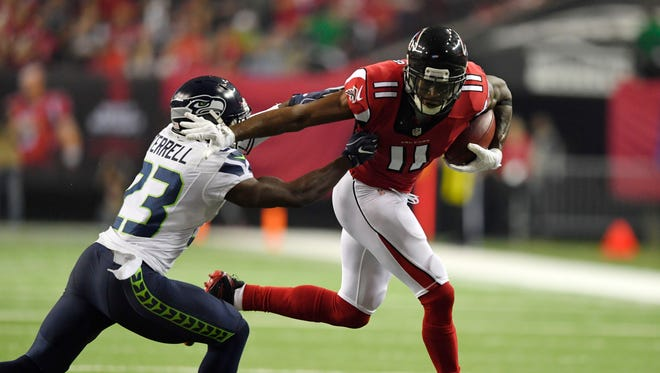 Jan 14, 2017: Atlanta Falcons wide receiver Julio Jones (11) runs after a catch against Seattle Seahawks free safety Steven Terrell (23) during the second quarter in the NFC Divisional playoff at Georgia Dome.
