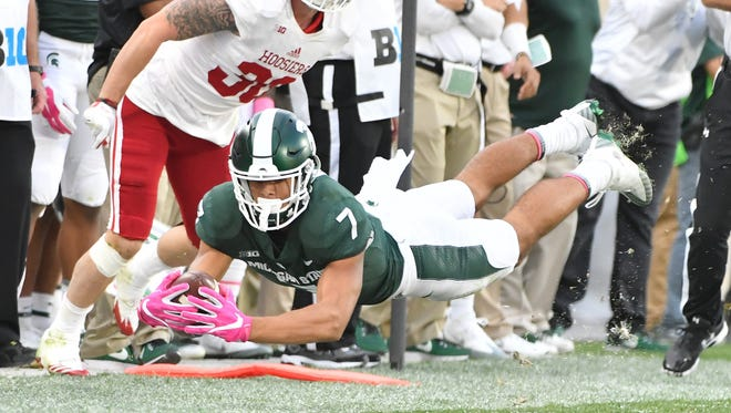 Michigan State's Cody White drives for a first down after a reception in the third quarter.