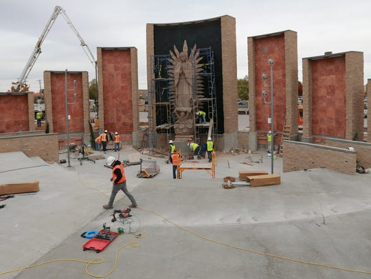 Construction continued Wednesday on the shrine of Our