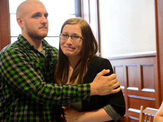 In this file photo, Katlin Wolfert is comforted by her friend Brandon Mackey after a guilt verdict was handed down on May 7 against Kenneth Stahli in the trial for the murder of her 2-year-old son Mason DeCosmo.