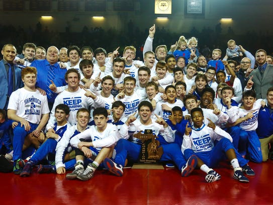 Detroit Catholic Central wrestling team celebrates MHSAA Division 1 title in Mount Pleasant.