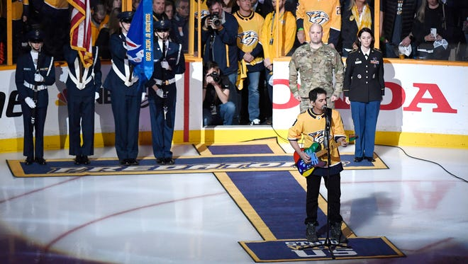 Brad Paisley performs the National Anthem before game 2 of the first round NHL Stanley Cup Playoffs at Bridgestone Arena Saturday, April 14, 2018, in Nashville, Tenn.