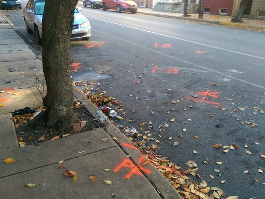 Debris and police markings remain Saturday morning from the scene of a Friday night shooting in the 300 block of East King Street. (By Sean Philip Cotter / The York Dispatch)