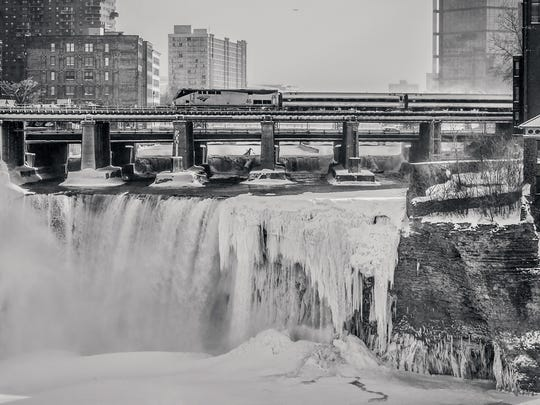 """Thomas Culligan II  took his image """"Frozen City"""" from the Pont de Rennes bridge at High Falls just as the Amtrak train was coming in to Rochester."""