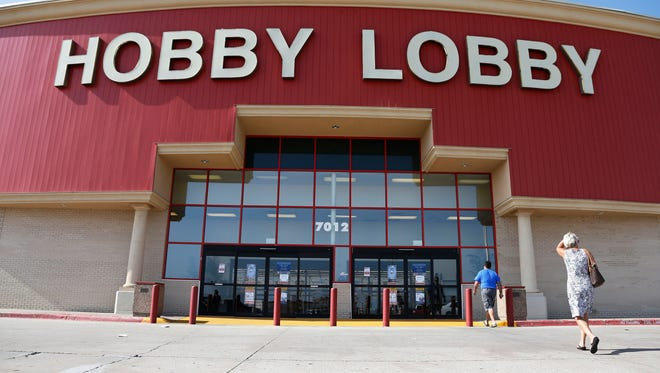 Customers walk to a Hobby Lobby store in Oklahoma City in 2014