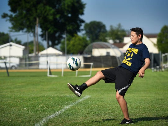 Saddle Brook HS junior David Guerra, who was undergoing serious leukemia treatments, kicks a ball as he is back on the field to warm up by his own to prepare for the season at Carmelo Virga Field in Saddle Brook on July 19th, 2017.