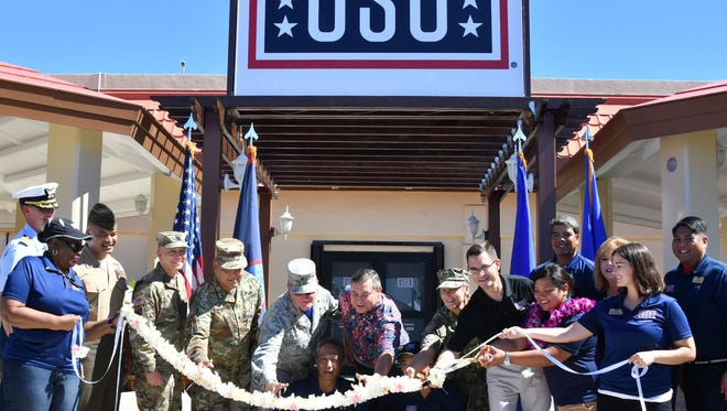 Military and local government officials as well as USO staff participate in a ribbon-cutting ceremony for the new USO center on Andersen Air Force Base on Friday, Sept. 29, 2017.