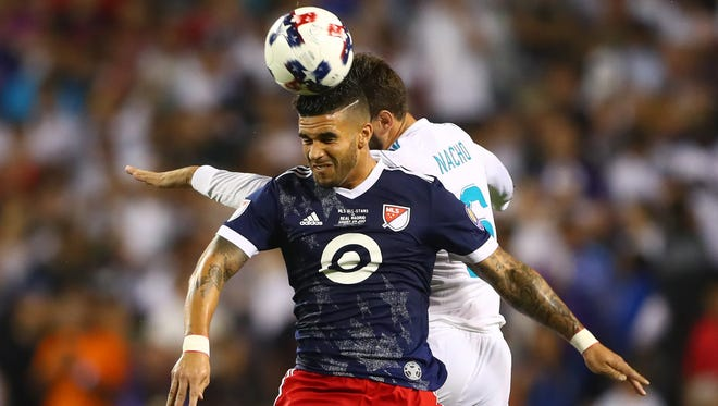 MLS All-Star Team and Orlando City SC forward Dom Dwyer (14) heads the ball against Real Madrid defender Nacho (6) in the second half of the 2017 MLS All-Star Game at Soldier Field.