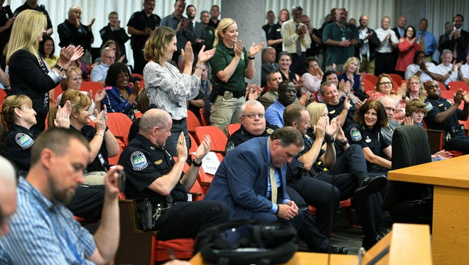 Deputy Chief Eve Thomas gets cheers and applause from the women after being named Knoxville's new chief of police by Mayor Madeline Rogero Thursday, June 21, 2018.