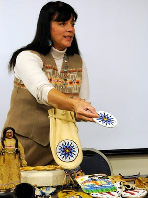 Bernadette Scott, a Mohawk and Blackfoot descendant, held a presentation about Native American heritage at the Oak Harbor Library on Monday night.