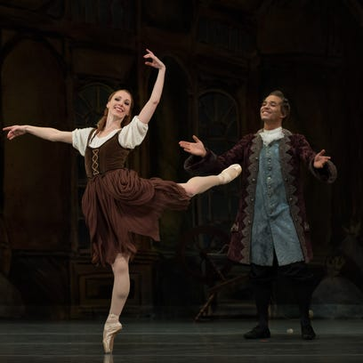 """Janessa Touchet dances the title role in Cincinnati Ballet's """"Cinderella"""" under the watchful eyes of her father, danced by Romel Frometa. Choreographed by artistic director Victoria Morgan and with music performed by the Cincinnati Symphony Orchestra, the show continues through Feb. 14 at the Aronoff Center. Photo: Peter Mueller."""