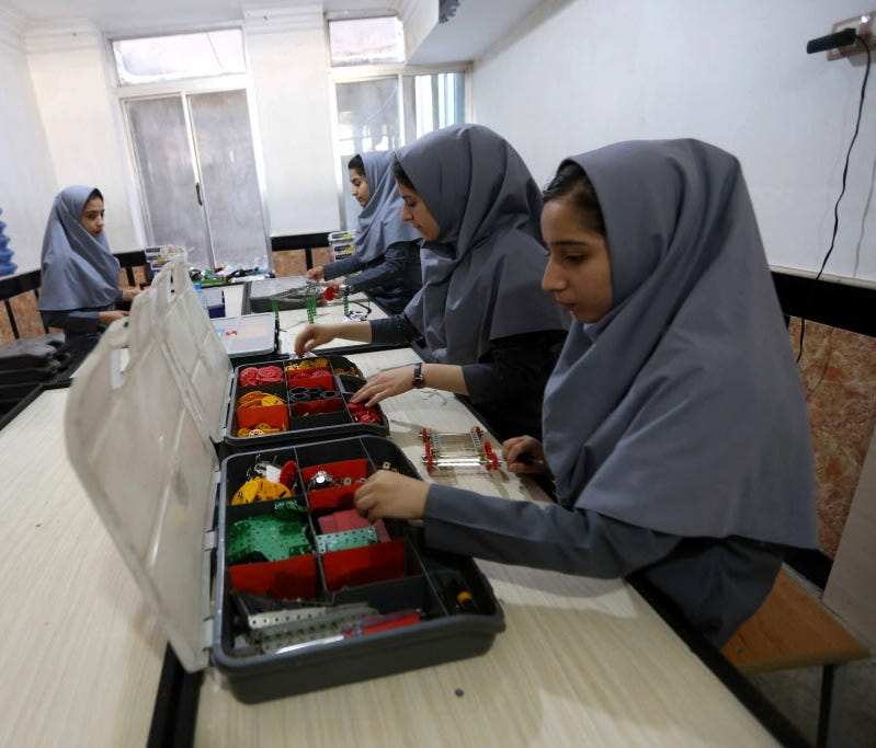 Afghan school girls work on robot machine at a school in Herat, Afghanistan on July 4, 2017. According to reports, six Afghan teenage girls have been denied visas to travel United States for an international robotics competition, but they will be per