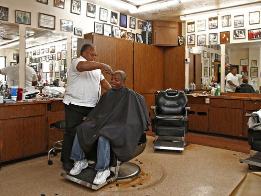 George Greathouse, who is retiring after cutting hair